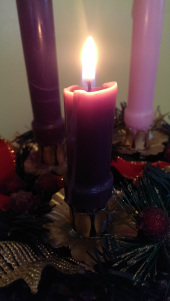 Candle of Hope lit on an Advent Wreath